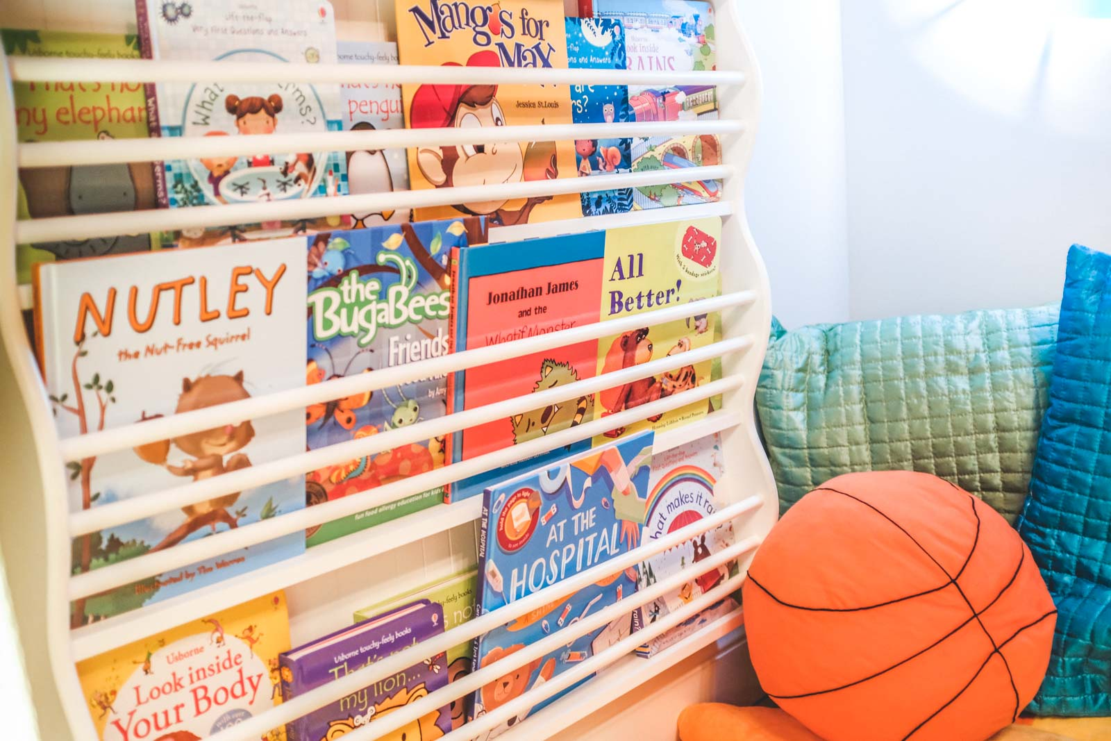 Best Food Allergy Kid's Books: Wall of kids books in a reading fort