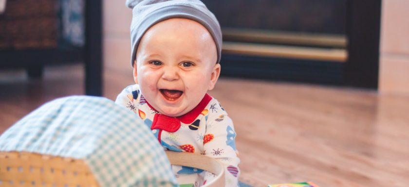 A baby excited to celebrate Easter with food allergies