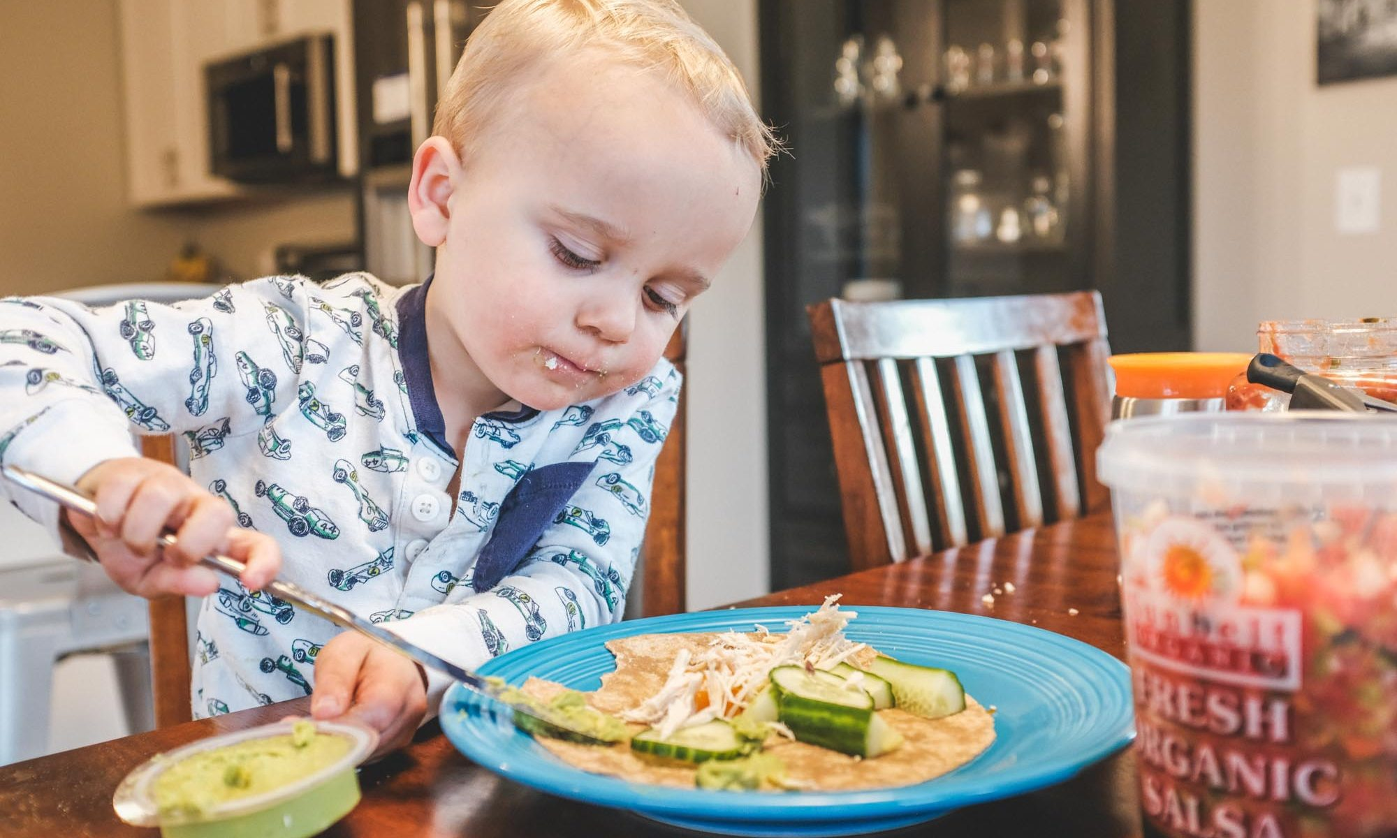 toddler independence is one of our dinner table tricks to keep him happy and fed, like here where he prepared his own wrap