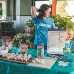 mom and toddler offering samples during one of their food allergy awareness events