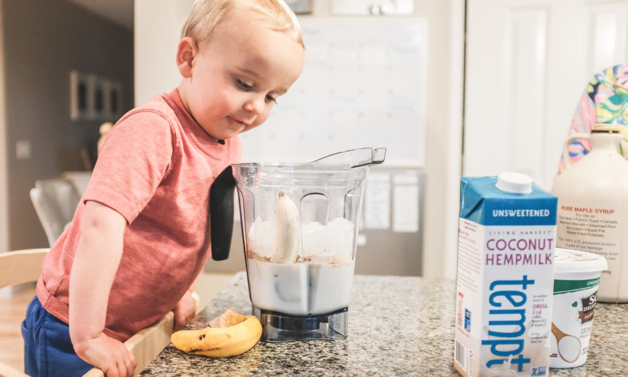 "toddler excited about a chocolate ""milkshake"" with ingredients from Healthy Living"