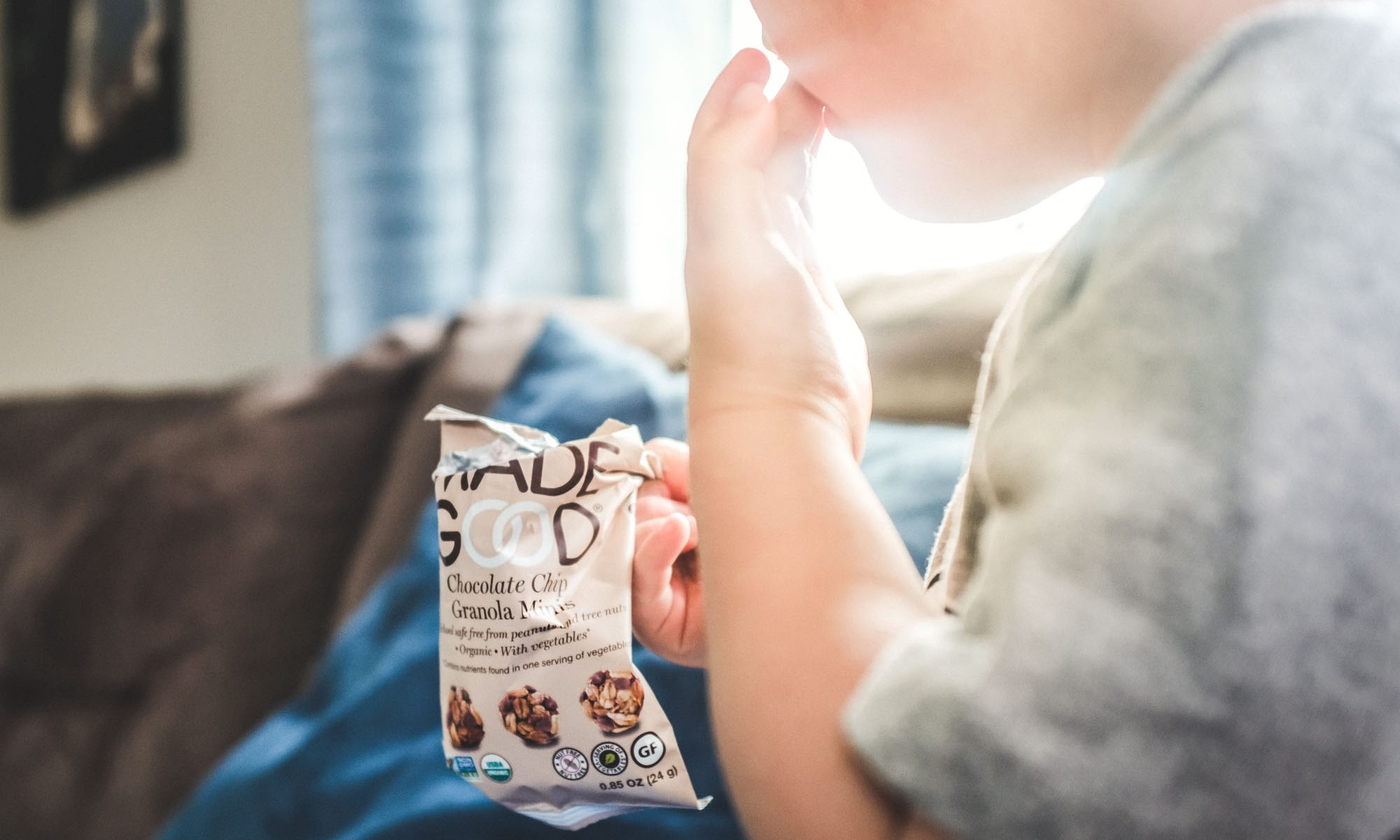 toddler eating madegood granola minis from Healthy Living