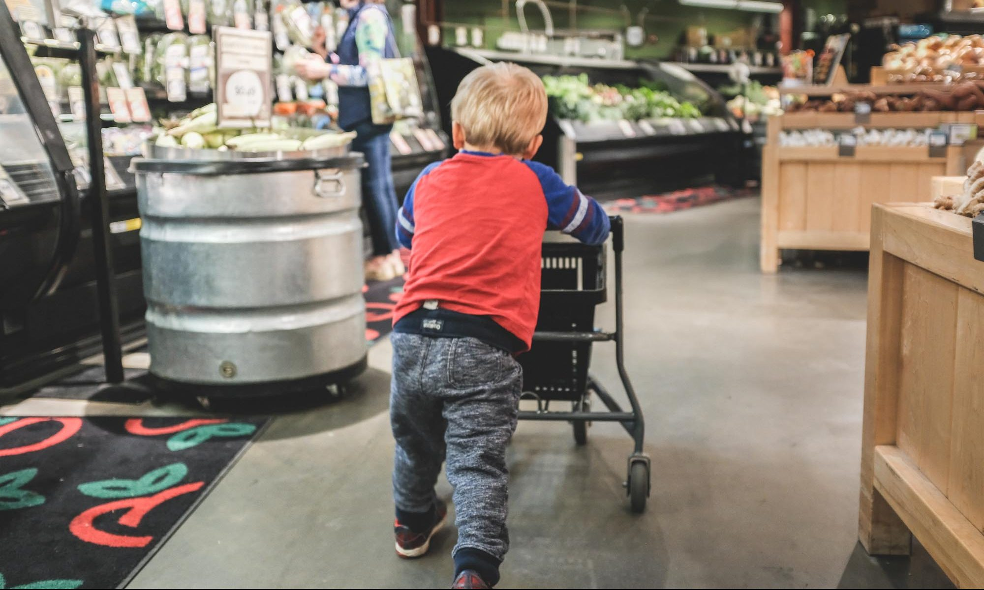 toddler and mom shopping for organic produce at Healthy Living
