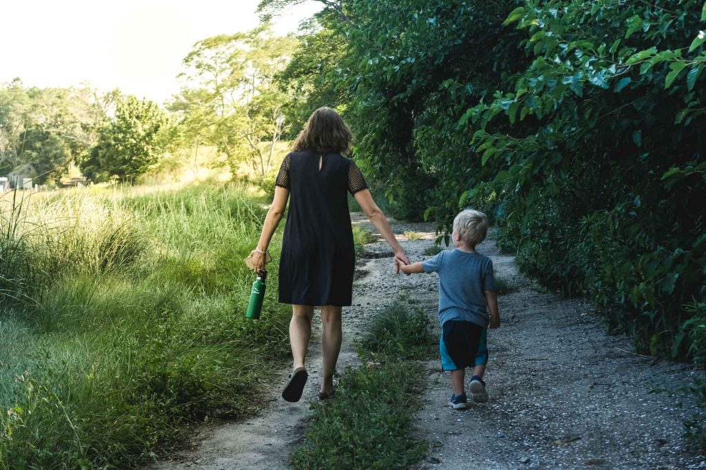 mom and son out walking during a summer vacation with food allergies