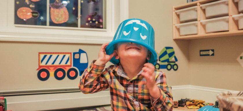 Ollie (with a teal pumpkin bucket on his head) is excited about all the allergy-aware Vermont events happening this year!